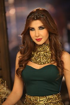 "Nancy Ajram Wearing Rami Kadi Couture In Her Latest Music Video ""Ma Awe'dak Ma Ghir"""
