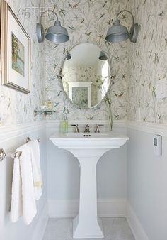 Rustic sconces, pedestal sink, whimsical wallpaper - perfect for the beach house - Design by Sarah Richardson