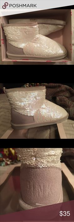 Victoria's Secret PINK boots Sparkly, white rhinestone UGG style low top boots. Super cute and cozy for winter time. Worn a few times but still in good condition. Original box included ! PINK Victoria's Secret Shoes Winter & Rain Boots