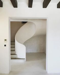 // the art of the perfect curving staircase - minimally executed by for their Na Freda project - the mix of texture and form brings my eyes ease, i can only imagine how relaxing it must be to inhabit this space //⁠⠀ . Concrete Staircase, Staircase Railings, Curved Staircase, Staircase Design, Stairways, Spiral Staircases, White Staircase, Staircase Ideas, Interior Stairs