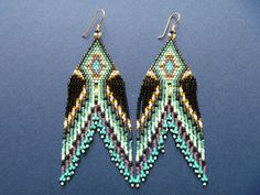 Brick stitch and fringe earrings by reddesigns