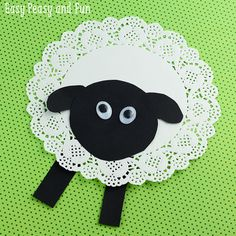 Adorable sheep craft made with a doily, cute preschool spring craft!