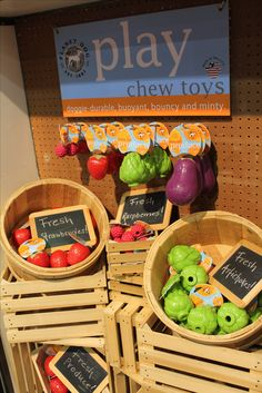 Fun way to display dog toys for sale. The sign at the top balances the display