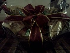 Self made Wine basket for donation... A little of this and that makes it work. Materials(Ribbon, basket, tissue paper, chocolates, wine, glasses, and basket plastic from Michaels)