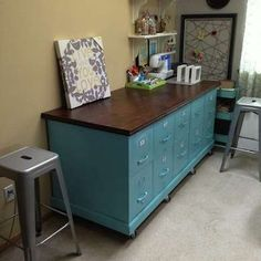 DIY Filing Cabinet Bench Craft Corner This craft counter is five separately obtained filing cabinets, all sprayed a uniform perky blue and mounted to a piece of plywood on casters. The top is another piece of plywood, stained in gorgeous walnut and trimmed out for a finished look. The assemblage offers plenty of real estate for both crafting and storing. We love this repurposed solution!