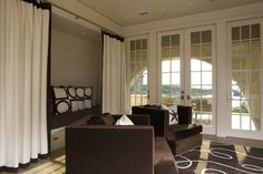 Could paint kitchen and dining room hot cocoa (SW) then have livingroom creamy on the outside and chocolaty in the middle. Try a cream hue reminiscent of milk or a marshmallow on the walls, then layer brown pieces through fabric and upholstery. Add brown banding to drapes and brown piping to your pillows for extra chocolate touches.  SW6077 Everyday White by Sherwin-Williams »  For creamy walls try this Everyday White paint from Sherwin Williams.