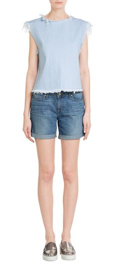 Styled+in+pale+blue+denim+with+a+boxy+shape,+this+Marc+by+Marc+Jacobs+top+is+detailed+with+a+frayed+hem,+adding+unfinished+cool+to+a+wardrobe+staple++#Stylebop