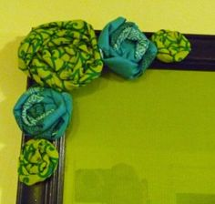 Lime Aqua Flowers- I like this idea, fabric flowers around frames for bathroom decor