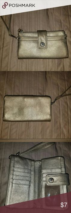 Cute wristlet! Wristlet/wallet in good used condition! No blemishes! More like a pewter color (in between gold & silver).. Bags Clutches & Wristlets