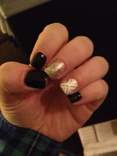 Black & gold acrylic nails.