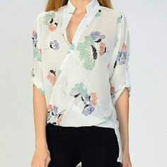 Light Flower Cross Top White sheer top with pastel flowers. Perfect for spring and into summer! Brand new retail item. Price is firm. Other sizes available. Happy Poshing! Moon Collection Tops Blouses