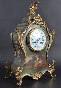 A LATE 19TH CENTURY FRENCH GILT METAL MOUNTED VERNE MATIN MANTLE CLOCK painted with romantic scenes. 16.5ins high.