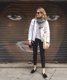 white denim jacket, striped top, black jeans