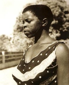 Africa | Makonde woman with traditional facial tattoos.  Northern Mozambique | Photographer unknown
