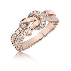 This breathtaking diamond tie-knot design ring features 1/5ct. t.w. brilliant round diamonds set in 10 karat rose gold