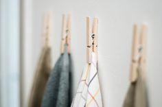 doing this tomorrow: gluing clothes pins to the inside of my kitchen cabinet doors under the sink.