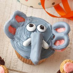 Elephant Cupcakes - like the use of the pretzels and good and plenty's.  Maybe use candy eyes and do the trunk in chocolate?