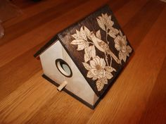 Wooden Pyrography decorated bird house. £10.00, via Etsy.