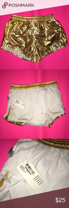 NWT American Apparel metallic gold shorts Small American Apparel draw strong shorts. Shiny metallic gold. Never worn. There is some discoloration on the white inside but this is just from the gold color. Unisex can fit men and women. American Apparel Shorts Athletic
