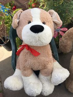 "Giant Puppy Dog 26"" Stuffed Animal Plush. Soft and cuddly. Wearing a cute Red bow. Light tan and cream colored. 