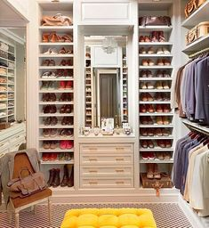 Perfectly organized closet | dream closet | white built-in shoe shelves | yellow button-tufted ottoman