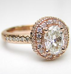 Oval Diamond Engagement Ring with double halo and diamond band in Pink Gold