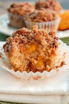 Moist and Delicious Peach Muffins with Crumb Topping for breakfast, a snack or a special treat for the office. Your going to love them!