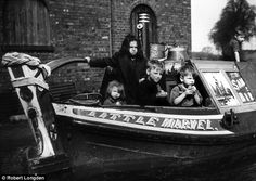 River children: Four children aboard the Little Marvel canal boat when the inland waterways were still a vital industrial link  Read more: