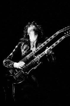Jimmy Page performing in 1975. Photo by Adrian Boot