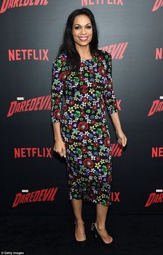 Flower power: Rosario Dawson went bold and bright with a flower print dress at the season two premiere of her show Daredevil in NYC on Thursday