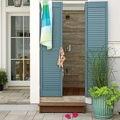 Our 2013 Showhouse in Daniel Island, South Carolina, is filled with design inspiration, including in the outdoor shower. Here, extra-long shutters painted the same shade of blue (St. Bart's by Sherwin-Williams) as the shutters on the front facade serve as