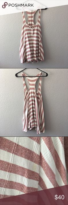 Free People Romper Adorable swingy romper by FP! Super comfy and has been worn but in good shape. Small stain by seam (pictured) but not noticeable  thanks to the gathering of the fabric towards the bottom. I'd say it can fit S to L easily Free People Dresses