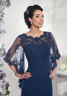 Elegant Mother's Gown Shown indark navy formal dress features lace illusion spanning the 3/4 bell sleeves, scalloped Sabrina neckline and lace back. Self-covered buttons conceal the back zipper closure on this A-line gown. 18 Colors Avaiable 14 Week Standard Delivery Rush Delivery Avaiable