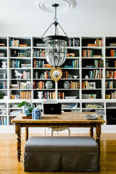 home office, study, library, charcoal gray on bookcases, farmhouse table, lantern pendant, gold federal mirror