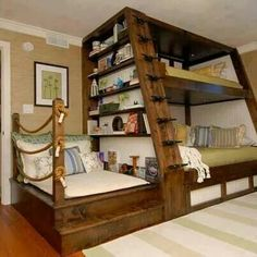 Love it. Wooden bunk with bookshelf and day bed attached.