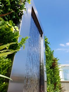 Stainless steel water feature with artificial green wall Artificial Green Wall, Water Walls, Paul Newman, Small Patio, Steel Water, Jacuzzi, Water Features, Wall Design, Terrace