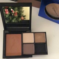 Mac Limited Edition compact Limited edition MAC Desert Camouflage full face. 4 eyeshadows & 1 Cremeblend blus/bronzer. Not sure that I ever used any of the shadows but I did test the bronzer once. 100% Authentic MAC Cosmetics Makeup