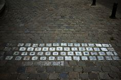 Timo Arnall came upon this artistic gem on the streets of Brussels, Belgium. It's none other than the clever AZERTY keyboard! This layout is specifically designed for the characters of the Latin alphabet on a typewriter or keyboard. What a perfect background for such witty street art.