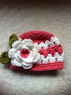 Pink newborn crochet hat with flower photography prop. why is it that all the newborn hats i see i actually would love to wear! lol