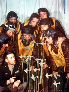 Captain instructs combat fliers on the fine points of formation flying. England