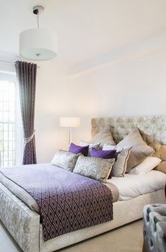 Soothing colors of grey and purple in this bedroom in Glasgow apartment ideal for couples and singles. luxury touches at the velvet decor with vintage furniture and Parish balcony!