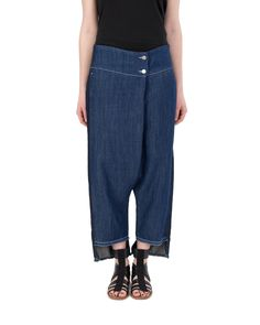 Denim low crotch sarong pants. Front closing with zip and button. Welt pockets and asymmetrical hem