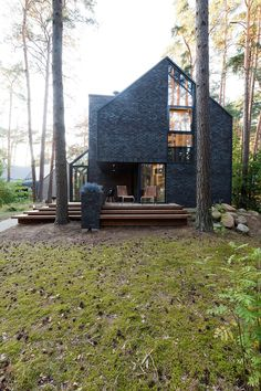 Modern Forest House Dedicated toBlues Music:Black House Blues - http://freshome.com/modern-forest-house-dedicated-to-blues-music-black-house-blues/