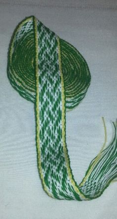 "Handwoven Inkle belt 1 1/4 "" x 103"" Celtic Knot in a pick-up pattern White, Green, and Yellow, Inkle, Inkle belt, SCA, Renessance.  Some of the uses for inkle bands are purse straps, belts, hat bands, camera straps, key fobs, dog leashes, dog and cat collars, lanyards, guitar straps, trim for SCA or Renn Faire clothes and handfasting bands.   Handwash, air dry.  If you see something you like, but"