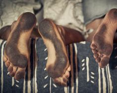 soles of dirty feet