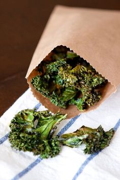 Kale chips - so good and so simple. Spread kale on baking sheet, sprinkle with olive oil and salt and pepper. Place in 350 degree oven for 15 minutes. Yum!