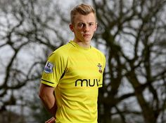 """James Ward-Prowse wearing the previously unseen """"Third Kit"""" yellow shirt in the 14/15 season."""