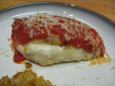 Mozzarella Stuffed Chicken Topped with Roasted Garlic Tomato Sauce and Parmesan cheese.