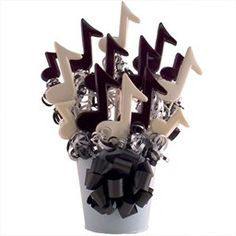 chocolate http://site.cool-party-favors.com/yswimages/music-themed-centerpieces-lollipop.jpg