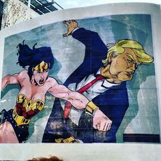 Wonder Woman punching Trump. Mural in south Philly, would be great for a feminist protest sign against misogyny #WomensMarch
